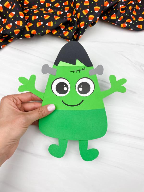 hand holding candy corn Frankenstein craft