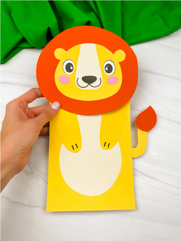 hand holding paper bag lion craft