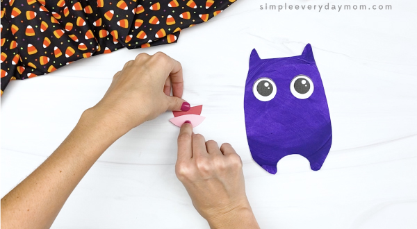 hand gluing tongue to paper plate bat mouth