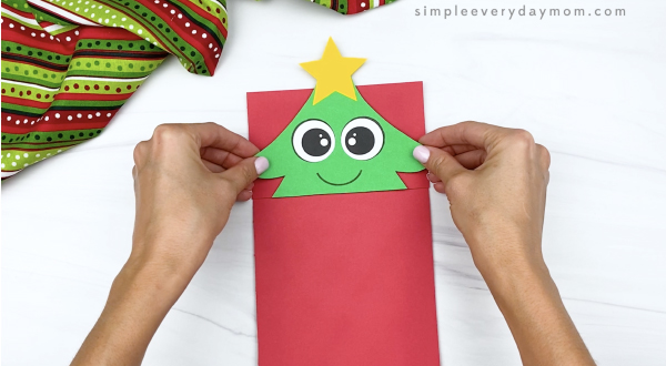 hand gluing top to paper bag Christmas tree craft