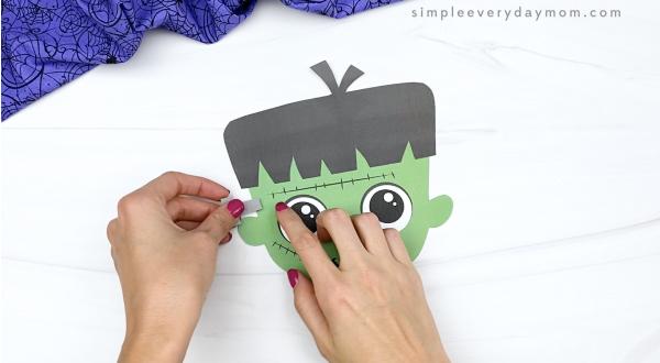 hand gluing bolts to Frankenstein craft