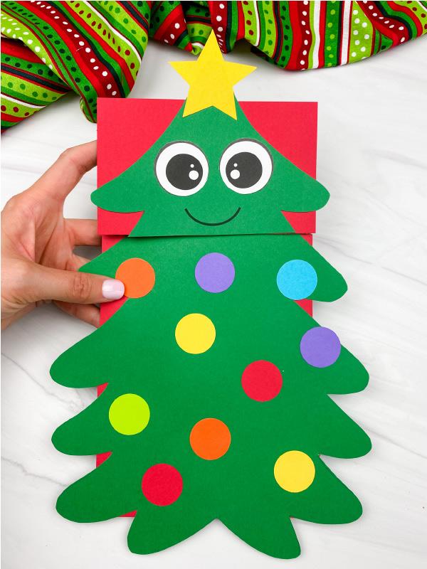 hand holding christmas tree puppet craft