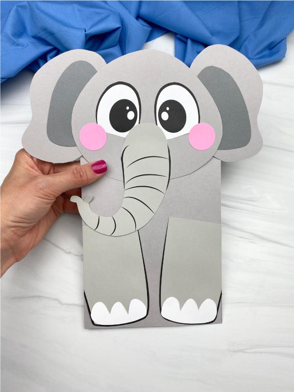 hand holding paper bag elephant craft