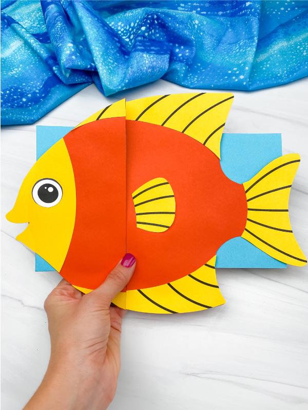 hand holding fish paper bag puppet craft
