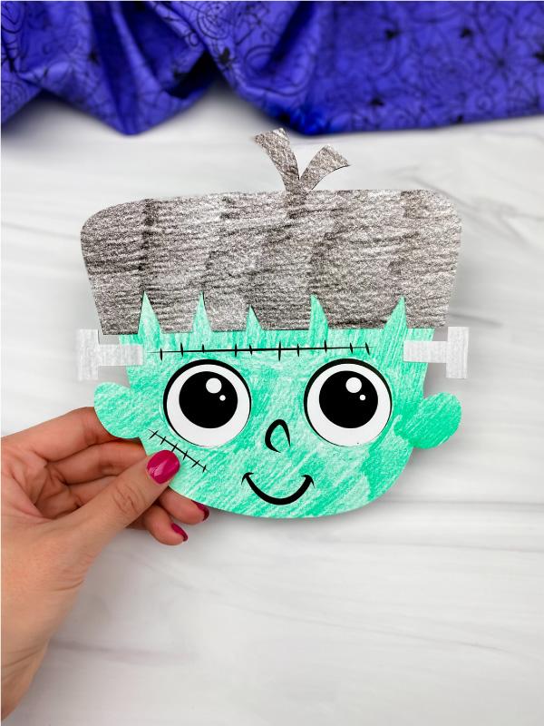 hand holding Frankenstein craft