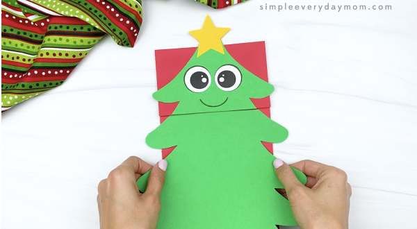 hand gluing base to paper bag Christmas tree craft