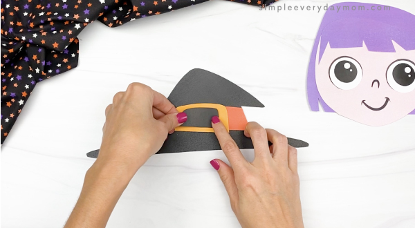 hand gluing inner buckle to outer buckle of printable witch craft