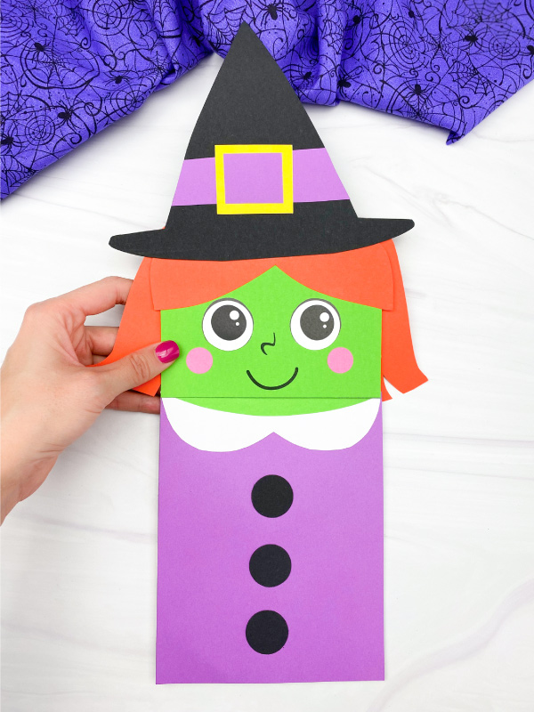 hand holding witch puppet craft