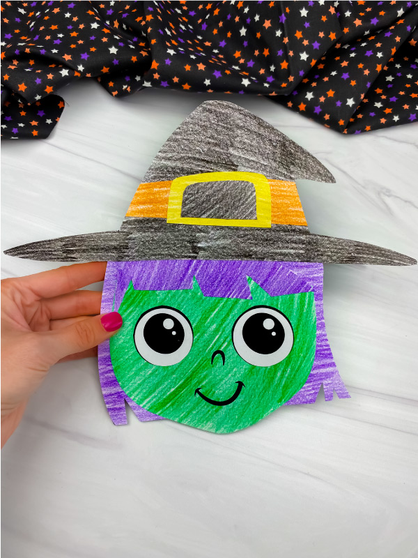 hand holding witch cut and paste craft