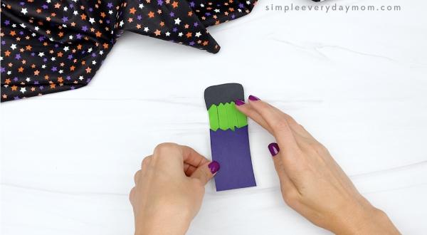 hand gluing shirt to popsicle stick Frankenstein craft