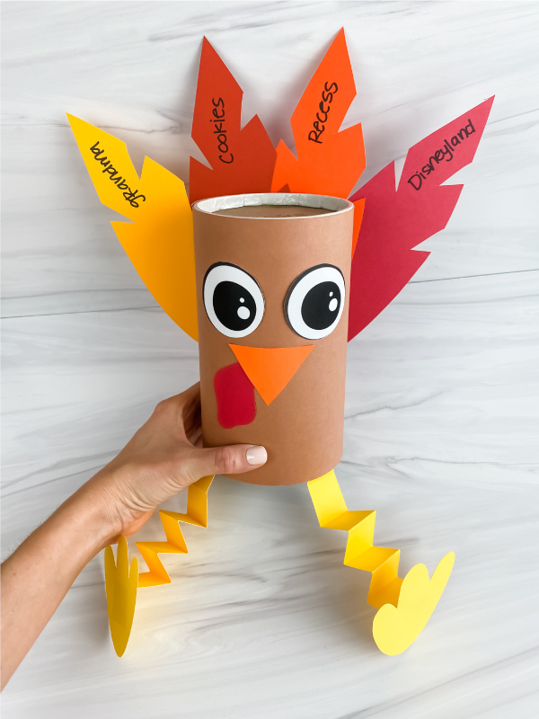 hand holding thankful turkey made from oatmeal container