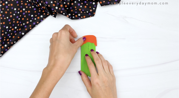 hand gluing bangs to popsicle stick witch craft