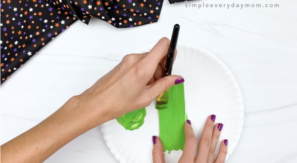 hand painting popsicle sticks green