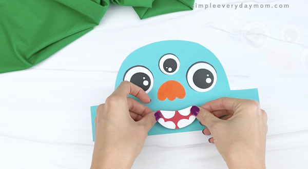 hand gluing mouth to monster headband craft