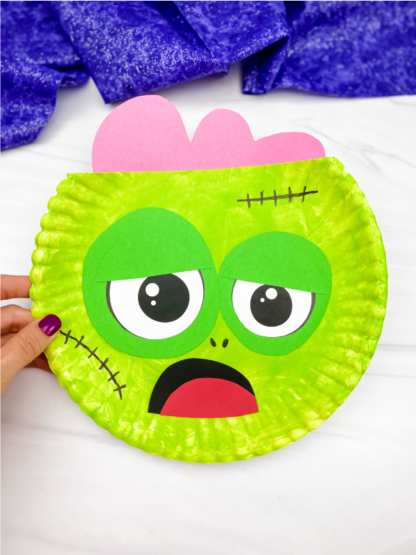 hand holding paper plate zombie