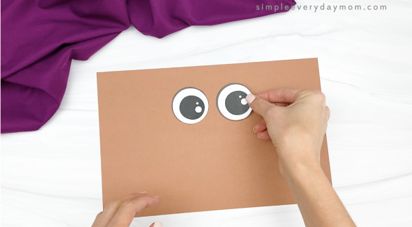 hand gluing eyes to oatmeal turkey craft