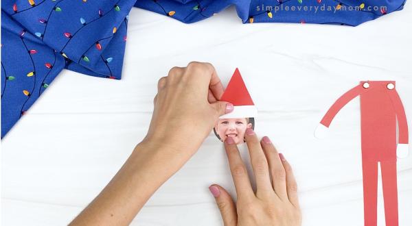 hand gluing hat to child's photo